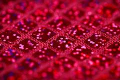 De heldere roze fuchsia schittert de stoffenachtergrond van het vierkantenlovertje Stock Foto