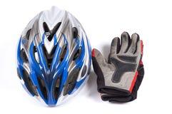 De helm en de handschoenen van de fiets stock afbeelding