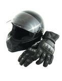 De helm en de handschoenen van de motorfiets stock fotografie