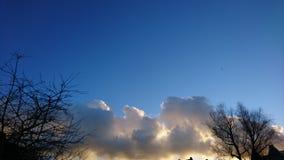 De hemelen van Cloudly Stock Foto