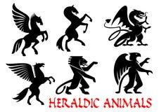 De heraldische mythische dieren silhouetteren emblemen Stock Fotografie