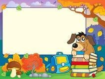 De herfstkader met hond en boeken Stock Foto's