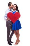 De het glimlachende hart en kus van de Paarholding Royalty-vrije Stock Afbeelding