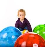 De het leuke Meisje en Ballen van de Baby royalty-vrije stock afbeeldingen