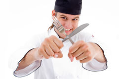 De het mannelijke mes en vork van de chef-kokholding Royalty-vrije Stock Foto