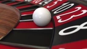 De het wielbal van de casinoroulette raakt rood 23 drieëntwintig het 3d teruggeven Stock Afbeelding