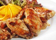 De hete Schotels van het Vlees - de Gebraden Vleugels van de Kip Stock Afbeeldingen