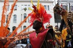De Heuvel Carnaval van Notting - oranje mens Stock Afbeeldingen