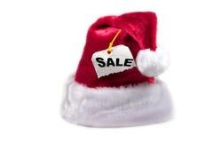 De hoed van de kerstman met een verkoopmarkering royalty-vrije stock foto's