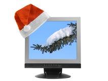 De hoed van de kerstman op een computervertoning Royalty-vrije Stock Afbeeldingen