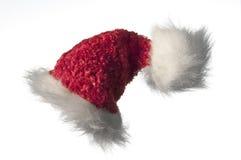 De hoed van de kerstman op wit Royalty-vrije Stock Afbeeldingen
