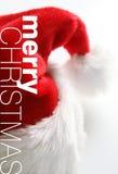De hoed van de kerstman op witte achtergrond Stock Foto's