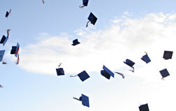 De hoeden van de graduatie Stock Afbeeldingen