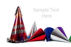 De hoeden van de verjaardag op wit met exemplaarruimte Stock Foto's