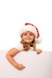 De hoedenmeisje dat van Kerstmis aan witte banner richt Stock Afbeeldingen