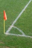 De hoek van de voetbal met vlag Stock Fotografie