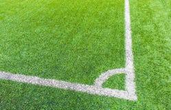 De hoek van het voetbalgebied met kunstmatig gras Royalty-vrije Stock Foto