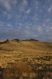De hoge berg van de woestijnzonsondergang Royalty-vrije Stock Foto's