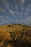 De hoge berg van de woestijnzonsondergang Stock Foto