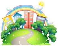 De hoge gebouwen en de regenboog royalty-vrije illustratie