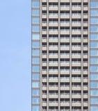 De hoge stijgings moderne bouw als patroon Stock Afbeeldingen