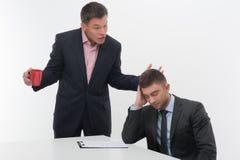 De hogere en ondergeschikte bedrijfsmensen bespreken Stock Afbeelding