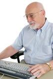 De hogere Mens geniet van Computer Stock Afbeelding