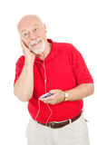De hogere Mens luistert aan MP3s Stock Afbeeldingen