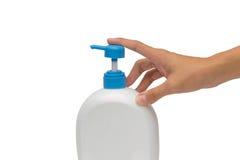 De holding of de pomp gelatineert, schuim of vloeibare die fles over witte B wordt geïsoleerd Royalty-vrije Stock Foto's