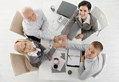 De holding van Businessteam overhandigt verenigd Royalty-vrije Stock Afbeelding