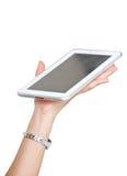 De Holding van de jonge Aziatische Vrouwenhand een Tablet. stock fotografie