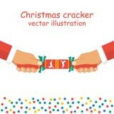 De holding van de Kerstmiscracker ter beschikking Stock Afbeeldingen