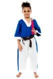 De holding van het karatemeisje nunchucks Stock Foto's