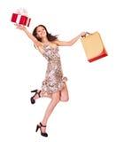 De holding van het meisje het winkelen zak. stock foto's