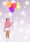 De holdingsBallons van het meisje royalty-vrije stock foto