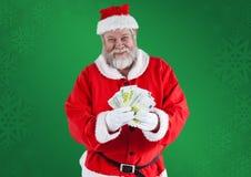 De holdingsbankbiljetten van de Kerstman Royalty-vrije Stock Afbeelding