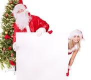 De holdingsbanner van de Kerstman en van het Kerstmismeisje. Stock Afbeeldingen