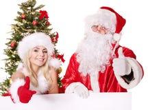 De holdingsbanner van de Kerstman en van het Kerstmismeisje. Royalty-vrije Stock Afbeelding
