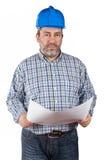 De holdingsblauwdrukken van de bouwvakker Royalty-vrije Stock Fotografie