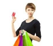 De holdingsdocument van de vrouw zakken en creditcard Stock Fotografie