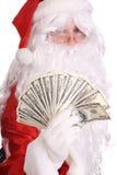 De holdingsgeld van de Kerstman. Royalty-vrije Stock Fotografie