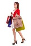 De holdingsgroep van het meisje het winkelen zak. stock fotografie
