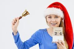 De holdingskalender en klok van de Kerstmisvrouw Royalty-vrije Stock Foto's