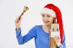 De holdingskalender en klok van de Kerstmisvrouw Stock Afbeeldingen