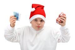 De holdingsKerstmis van de jongen stelt en euro geld voor Royalty-vrije Stock Afbeeldingen