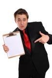 De holdingsKlembord van de mens met blanco pagina Stock Foto's