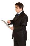 De holdingsklembord van de zakenman en het controleren van nota's Royalty-vrije Stock Fotografie