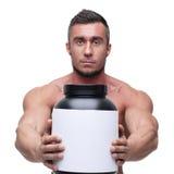 De holdingskruik van de mensenholding met proteïne stock foto's