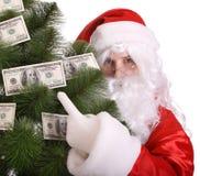 De holdingspijnboom van de Kerstman met geld. Royalty-vrije Stock Afbeelding