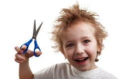 De holdingsschaar van het kind Stock Afbeelding